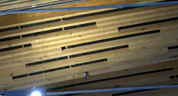 Pine Beetle infested wood arranged into a nice pattern along the roof of the Richmond Olympic Speed Skating Oval