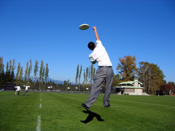 Uniformed Ultimate player leaps for the disc