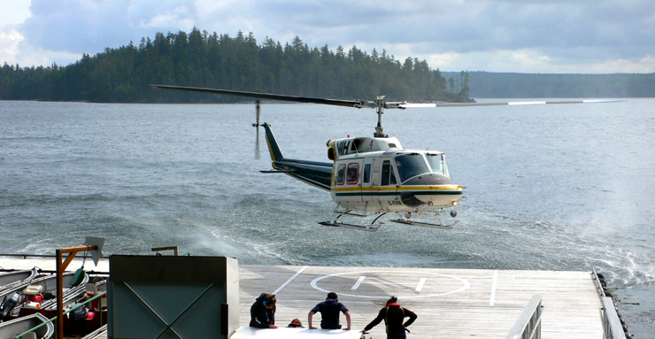 Bell Helicopter coming in to land on the floating dock at Langara Island Lodge